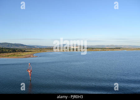 Landscape around Olbia, view from cruise ship arriving into the Olbia harbor in Sardinia - Stock Photo