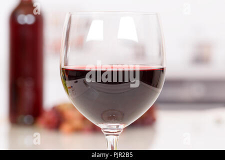Red wine in a glass drink alcohol - Stock Photo