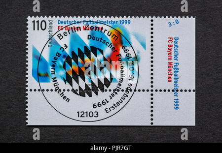 German stamp with first day of issue postmark - Stock Photo
