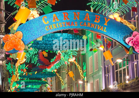 Christmas decorations at night on Carnaby Street, London November 25 2017 - Stock Photo