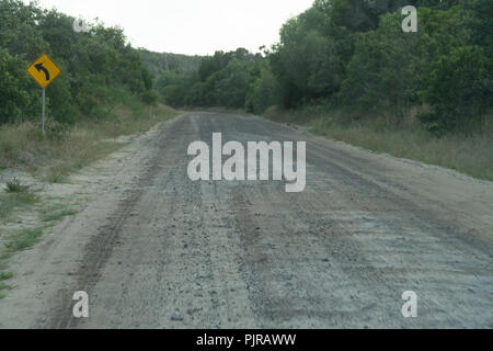 Road sign on a gravel road through the jungle of Fraser Island, Australia - Stock Photo