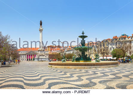 Lisbon, Portugal - June 21, 2018: Column Pedro IV and Fountain on Rossio Square located at Baixa district. - Stock Photo