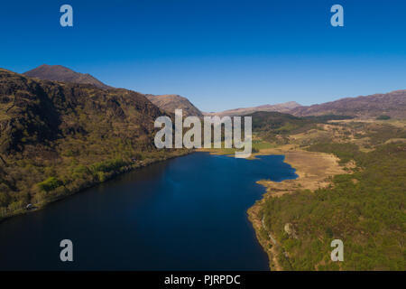 Aerial drone view of LLYN DINAS, which feeds water into the GLASLYN RIVER , near BEDDGELERT in the heart of Snowdonia National Park, Gwynedd , North Wales UK   [image made by CAA licenced and insured drone operator] - Stock Photo