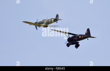 Westland Lysander (V9367) Supermarine Spitfire (AR501) flying at Old Warden Military Pageant Airshow on the 1st July 2018 - Stock Photo
