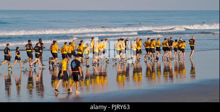 United Sates Marines in physical training clothing running on the beach at Camp Pendleton South in southern California, USA in the early morning - Stock Photo