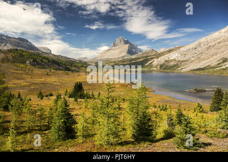 Baker Lake Autumn Landscape and Distant Rocky Mountain Peaks near Lake Louise in Banff National Park, Canadian Rocky Mountains - Stock Photo