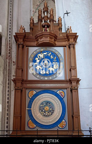 The Astronomical clock in St. Mary's Church located in Lubeck, Germany - Stock Photo