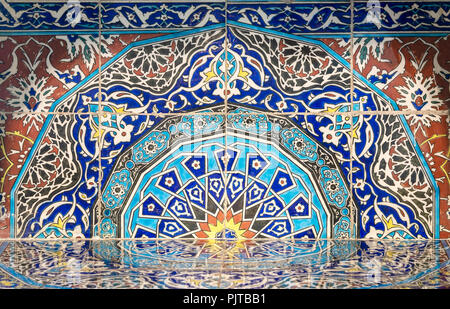 Part of fireplace from the royal era built of Turkish glazed ceramic tiles with floral ornamentations manufactured in Iznik - Stock Photo