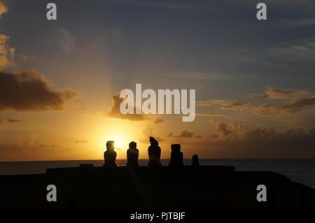 Sunset over the Moai heads at Ahu Tahai, Easter Island (Rapa Nui), Chile - Stock Photo