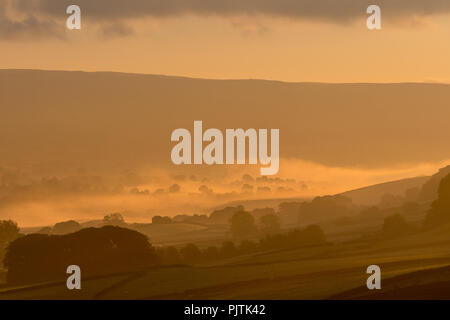 Early morning sunrise in upper Wensleydale near Hawes on an early Autumn morning. North Yorkshire, UK. - Stock Photo