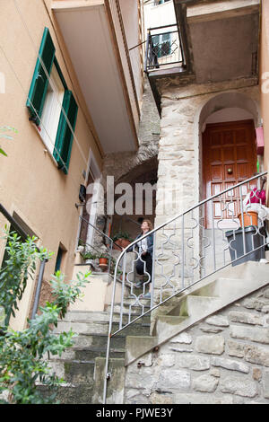 the streets of Manarola are typically lined with many stairs to access the homes which are built on the cliffside - Stock Photo