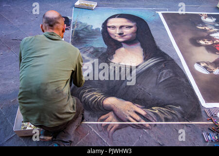 Florence, Italy / April 23, 2017 - Street artist paints the Mona Lisa using chaulk - Stock Photo