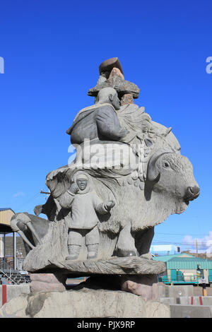 Stone carving Showing Inuit and Arctic Animals, Iqaluit, Baffin Island - Stock Photo