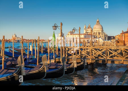 Venetian gondolas at sunrise in Grand Canal near San Marco - Stock Photo