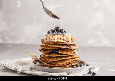 Stack vegan blueberry pancakes with peanut butter and syrup. Clean eating concept. - Stock Photo