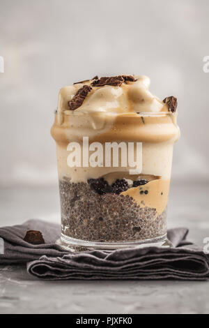 Vegan breakfast, chia pudding and banana ice cream with chocolate. Healthy trend, vegan concept, Clean eating food. - Stock Photo