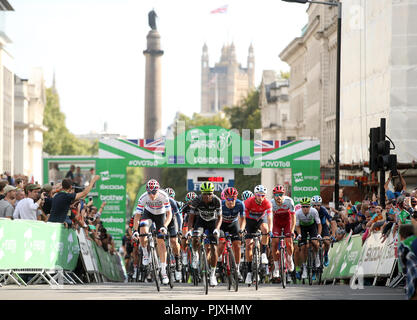Riders start stage eight of the Ovo Energy Tour of Britain 2018 around London. - Stock Photo