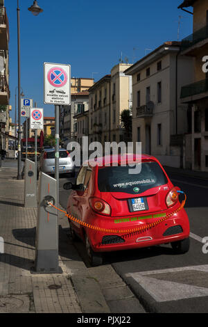electric car being charged on street in Italy - Stock Photo
