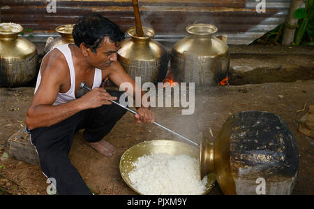 Cooking Food  Outdoors Using Fire Woods in Village - Stock Photo