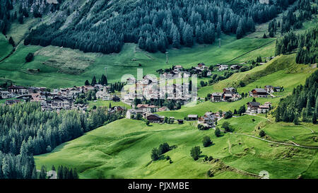 Little village of Colfosco on the hills with green meadow in summer season, Alta Badia - Trentino-Alto Adige, Italy - Stock Photo