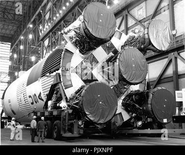 Cape Canaveral, FL - (FILE) -- The S-1C booster for the Apollo 11 Saturn V was erected atop its mobile launcher in the spaceport's Vehicle Assembly Building (VAB) on February 21, 1969.  Apollo 11 was the first in the Apollo series to have the capability of staging a manned lunar landing and launched on July 16, 1969.  Members of the Apollo 11 prime crew were Neil A. Armstrong, commander; Michael Collins, Command Module (CM) Pilot; and Edwin E. 'Buzz' Aldrin, Jr., Lunar Module (LM) pilot.  The giant booster is 138 feet (42.0624 meters) tall, 33 feet (10.0584 meters) in diameter and produces 7.5 - Stock Photo