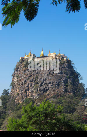 View of the buddhist site at the top of the pedestal hill of Taung Kalat (Mount Popa), Myanmar (Burma). - Stock Photo