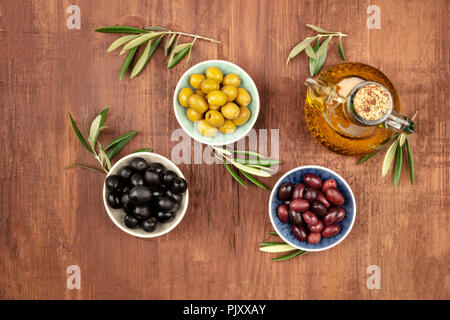 Overhead photo of various olives and olive oil with copy space - Stock Photo