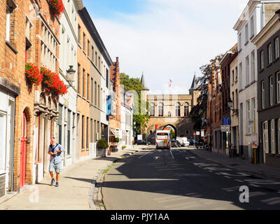 Gentpoortstraat and the Gentpoort gate - Bruges, Belgium - Stock Photo