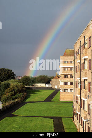 A rainbow arcking over 'Sir John Knott Memorial Flats' on the banks of the river Tyne at Tynmouth, UK. - Stock Photo
