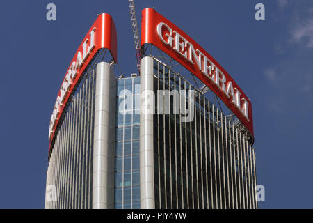 Sign of the Assicurazioni Generali Italian insurance company on top of the Generali Tower in Milan designed by Zaha Hadid Architects - Stock Photo