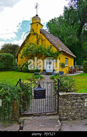 'Diana Cottage, a pretty stone built thatched cottage in the small village of Merthyr Mawr, near Bridgend, South Wales. - Stock Photo