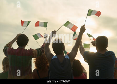 Group of people waving italian flags. - Stock Photo