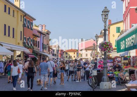 Caorle, Italy (8th September 2018) - Rio Terrà delle botteghe, the main pedestrian street of Caorle, crowded by people during summer - Stock Photo