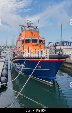 the RNLI lifeboat at Yarmouth on the isle of wight moored in Yarmouth harbour. - Stock Photo