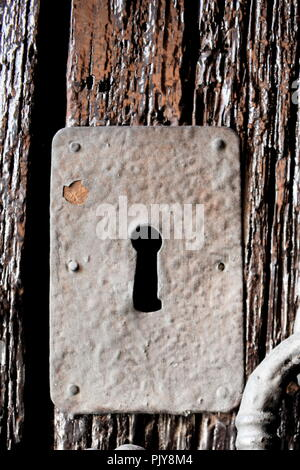 An old fashioned lock and key hole in the village of Frigiliana in Spain - Stock Photo