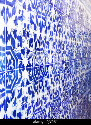 Mosaic tiles, Portugal Azulejo Classic and Traditional. Blue Patterned wall, medieval ceramics tile, heritage. Painted panel with a round geometric pattern. Mauritanian Wallpeper from Lisbon city - Stock Photo