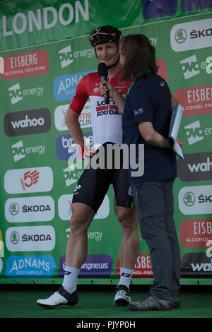 London,UK. 9th September 2018. Interview with German sprinter Andre Greipel of the Belgian Team Lotto Soudal, asking about his chances to sprint to victory, his third, in this stage 8, the Criterium of London. It is the last stage of the Tour of Britain 2018 Criterium of London. Credit: Joe Kuis/Alamy Live News - Stock Photo