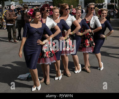 Goodwood, Britain. 9th Sep, 2018. Women dressed in vintage clothes attend the Goodwood Revival 2018 in Goodwood, Britain, on Sept. 9, 2018. Credit: Han Yan/Xinhua/Alamy Live News - Stock Photo