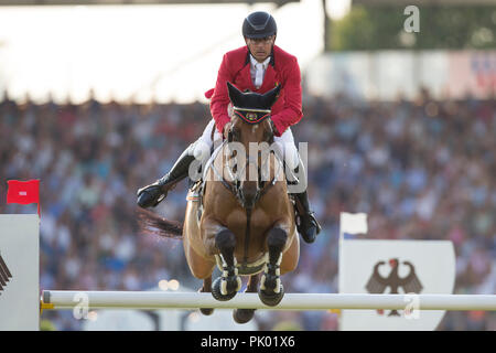 Aachen, Deutschland. 19th July, 2018. Yves VANDERHASSELT (BEL) on Jeunesse jumping over the obstacle. Action/single action. CHIO Aachen 2018, S8, Mercedes-Benz Nations Cup, Team Jumping Competition. 19.07.2018 in Aachen/Germany. | Usage worldwide Credit: dpa/Alamy Live News - Stock Photo