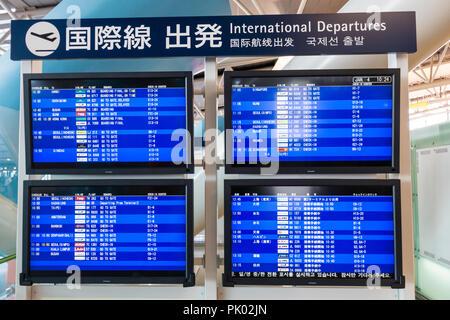 Japan, Osaka. Kansai International Airport. KIX, Interior terminal 1, fourth floor international departures. International departures display boards. - Stock Photo