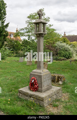 WW1 war memorial in the churchyard of the parish church of All Saints in the Bedfordshire village of Milton Ernest, UK - Stock Photo