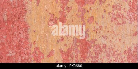 Old weathered painted wall background texture. Red dirty peeled plaster wall with falling off flakes of paint. - Stock Photo