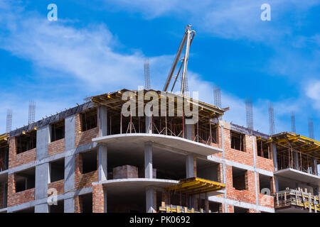 Automobile concrete pump. Construction site. New multi-storey building. - Stock Photo