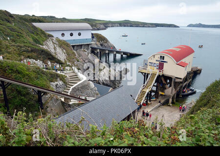View of the Old Lifeboat Station, with new lifeboat station behind, at St Justinians, St Davids Coast, Pembrokeshire, Wales, UK - Stock Photo