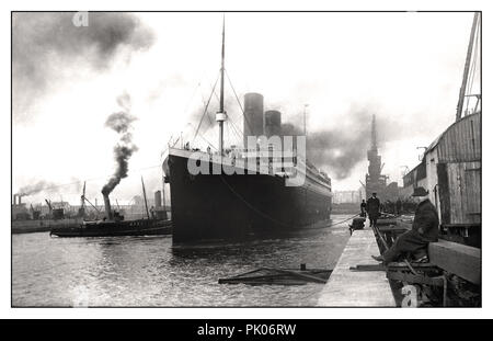 RMS TITANIC leaving Harland & Wolff shipyards April 2nd 1912 Sombre still dawn image of Titanic casting off on her fateful maiden voyage - Stock Photo