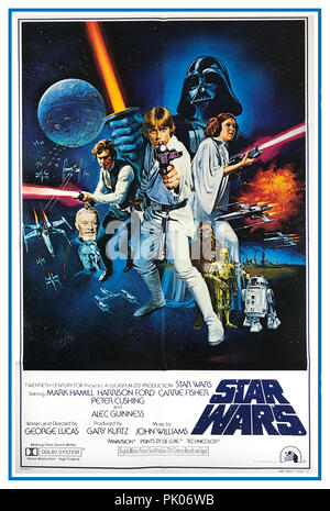 "STAR WARS, 1977. Original international style movie film poster starring Mark Hamill, Harrison Ford, Carrie Fisher, Alec Guinness, Peter Cushing and directed by George Lucas. ""A long time ago in a galaxy far, far away…"" - Stock Photo"