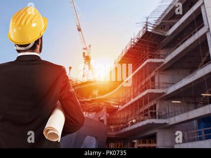 Businessman Architect analyzes the works of a building - Stock Photo