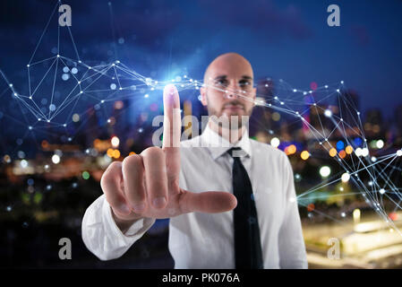 Businessman works with futuristic internet interface - Stock Photo
