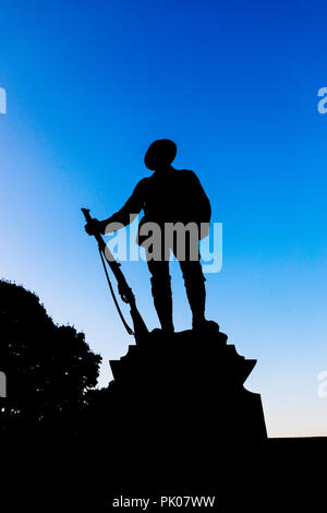 King's Royal Rifle Corps War Memorial, Winchester, statue of a soldier in Winchester Cathedral Close, Winchester, Hampshire, southern England, UK - Stock Photo