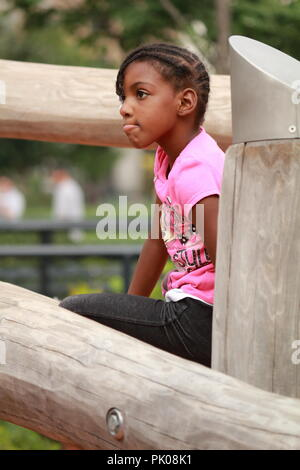 African American girl playing on playground - Stock Photo
